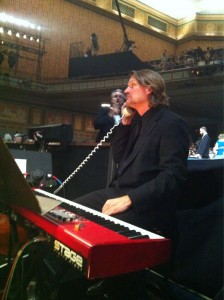 David O playing a stage keyboard in a theatere