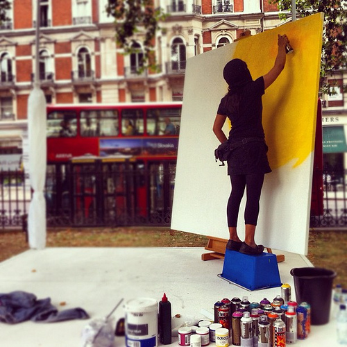 An artist paints a Klimt-inspired painting in Grosvenor Square, Victoria