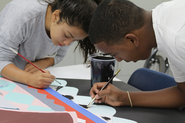 Armory Art High student Dalon Poole (right) and friend create a collaborative mural on panel at the La Pintoresca Teen Education Center in Pasadena.